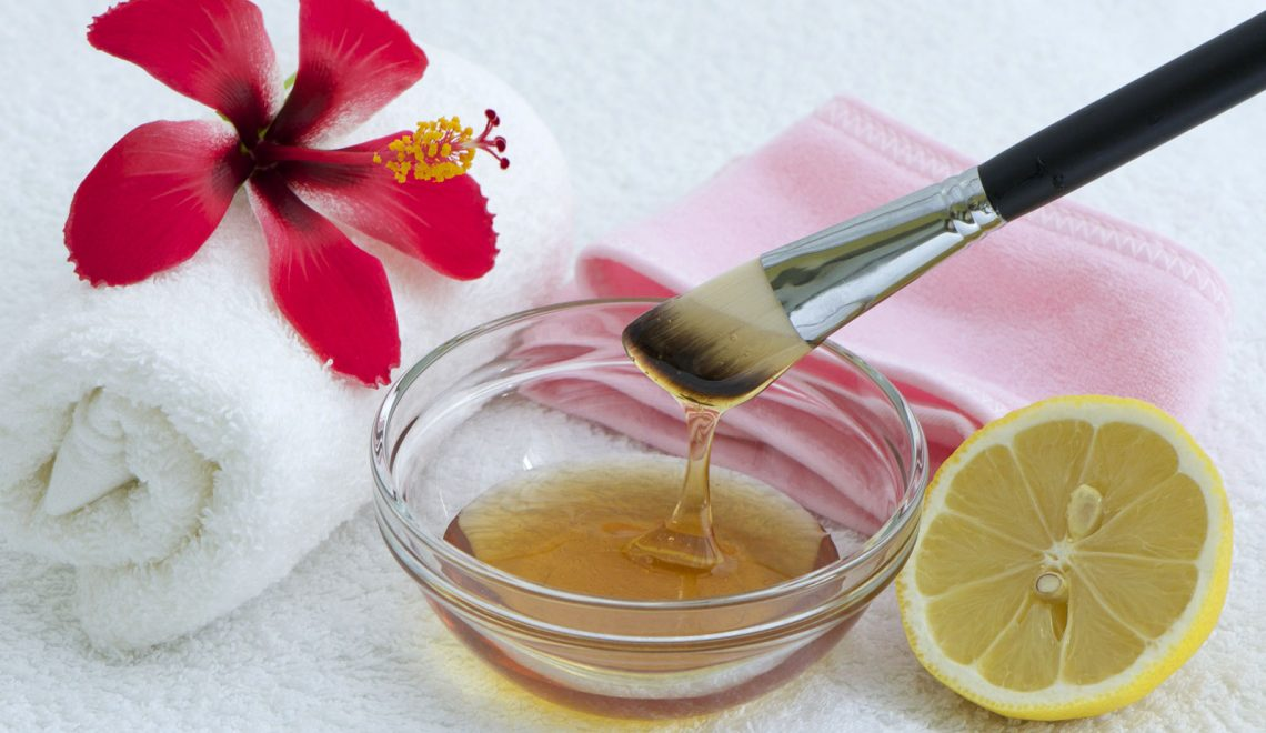 bowl and brush with raw honey and beauty items
