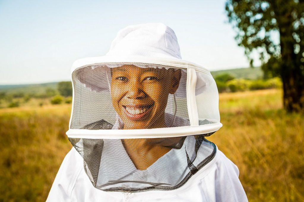 Female beekeeper Mokgadi Mabela of Native Nosi in beekeeper outfit