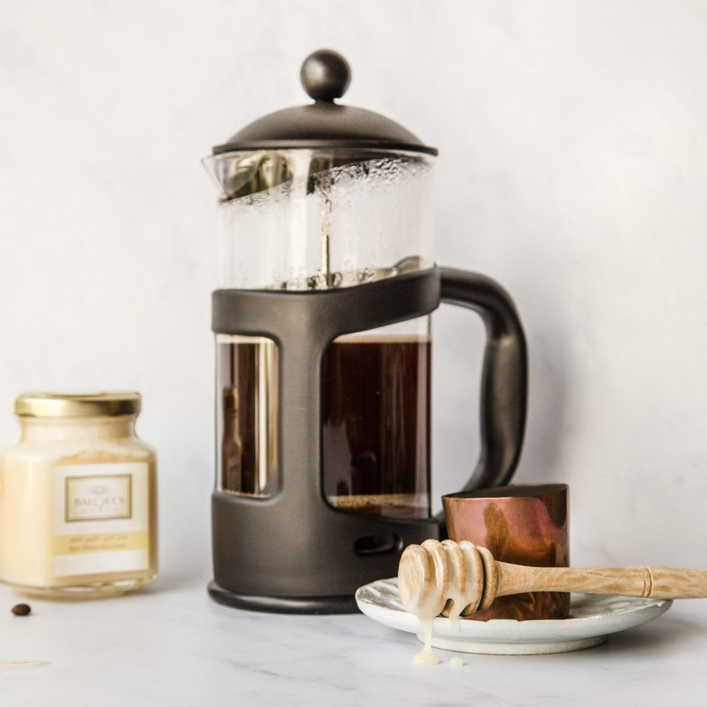 caftiere of coffee with white mountain honey on a drizzler