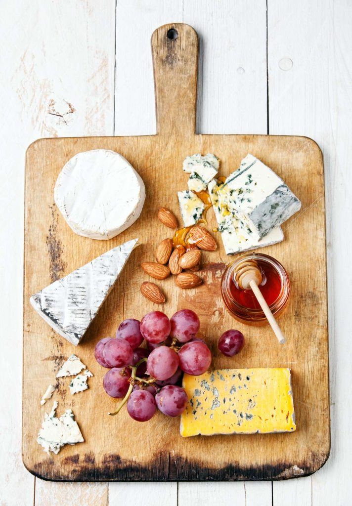 Cheese and honey on a cheese boards
