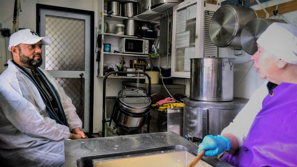 Man and woman in a cheesemaking room